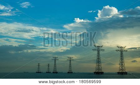 powerline on the sea and blue sky