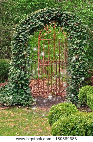 Wrought Iron Gate covered in ivy with Fairies dancing in garden