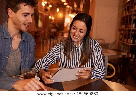 Happily Smiling Millenial Couple In Restaurant