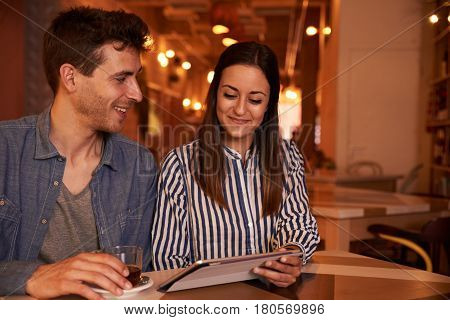 Joyously Happy Young Couple In Restaurant