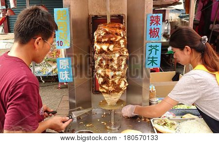 Preparing Shawarma Meat In Bread Buns