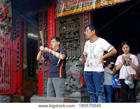 Praying At A Temple In Taiwan