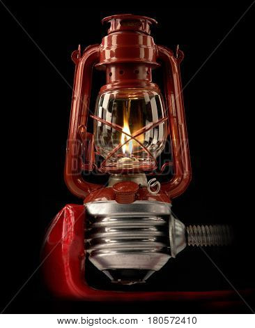 a kerosene lamp on a black background