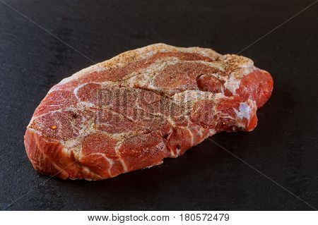 Raw Pork Meat On A Graphite Black Table