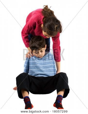 A young boy being helped by his sister after tripping over, isolated on white.