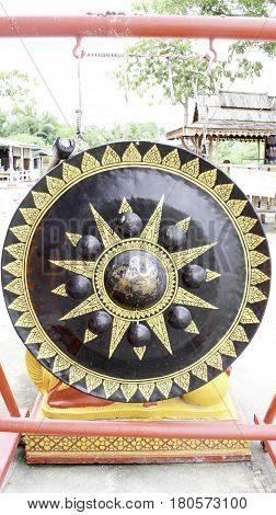 Gongs are broadly of three types. Suspended gongs are more or less flat circular discs of metal suspended vertically by means of a cord passed through holes near to the top rim. Bossed or nipple gongs have a raised centre boss and are often suspended and