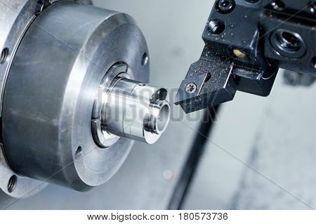 cutter tool at metal working on lather machine