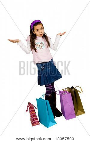 A little girl wondering , with bags of shopping, isolated on white.
