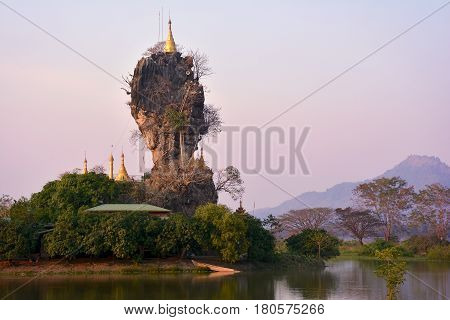 Beautiful View Of Kyauk Kalap Pagoda At Sunset In Hpa-an, Myanmar. Mountains On The Background.