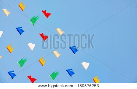 colorful flick flag on blue sky celebrities symbol