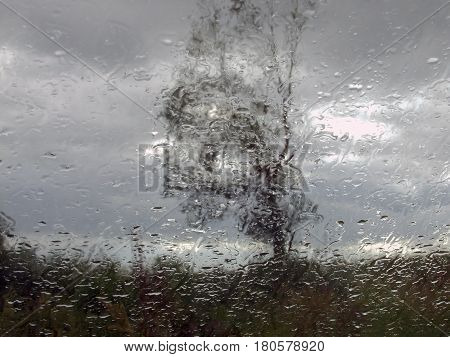Flowing Down Drops Of Rain On Glass