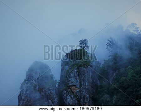 Morning mist and fog, covers the iconic Rock Pillars in Kodaikanal, Tamil Nadu, India, a traveller can see the years of Nature's handiwork.