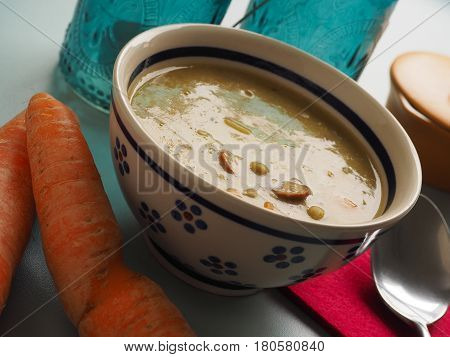 Organic soup of peas in a rustic ceramic bowl