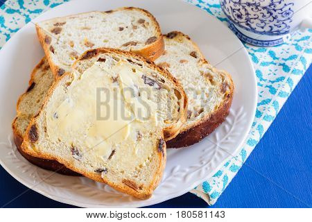 Bara Brith or Speckled Bread a traditional Welsh fruit loaf made with sultanas or raisins often eaten buttered