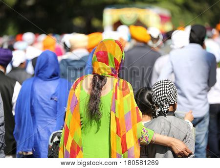 Vicenza, Vi, Italy - April 8, 2017: Women With Colorful Clothes And Veils To Cover Their Heads Durin