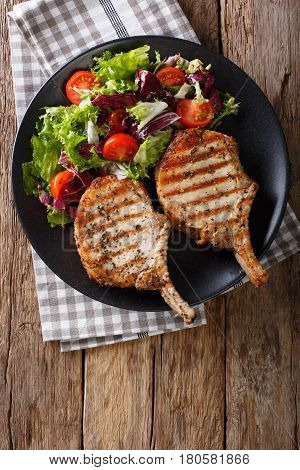 Bbq Spicy Pork Cutlet With Mixed Salad On A Plate Close-up. Vertical Top View