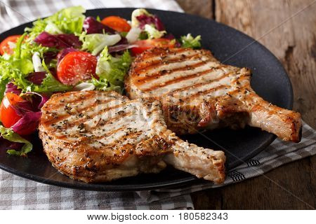 Grilled Spicy Pork Cutlet And Fresh Salad Close-up On A Plate. Horizontal