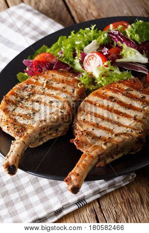 Bbq Spicy Pork Cutlet With Mixed Salad On A Plate Close-up. Vertical