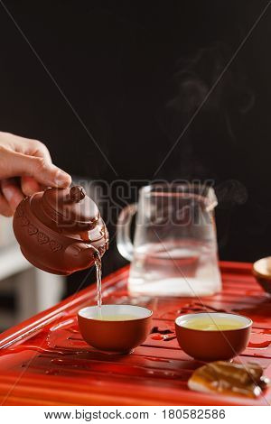 The Tea Ceremony. Woman Pours Tea In A Tea Bowl.