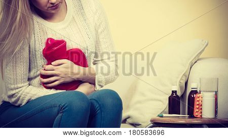 Woman Feeling Stomach Cramps Sitting On Cofa