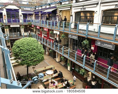 LONDON - APRIL 4, 2017: Shops, bars, restaurants and outdoor dining on the three levels of Kingly Court just off Carnaby Street in Soho, Westminster, London, UK.