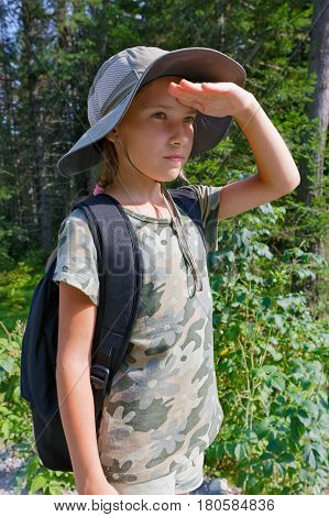A teenage girl is traveling through the taiga