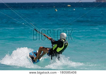 Saint Martin French Antilles March 22 2017: A kitesurfer has just launched and started surfing.