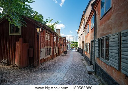 Skansen open-air museum and zoo in Sweden located on the island Djurgarden in Stockholm. Old swedish traditional village. Scandinavia Europe. poster