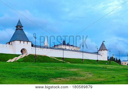 Towers and white-stone walls of Kazan Kremlin in evening Kazan Russia