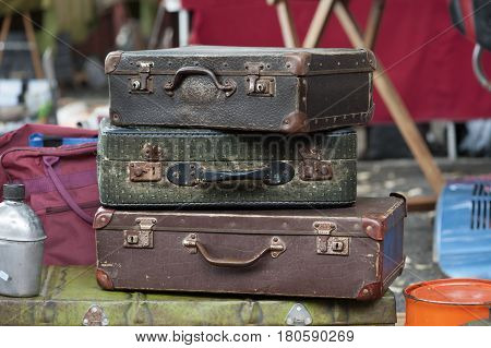 stack of vintage suitcase luggage at the flea market in Lisbon, Portugal