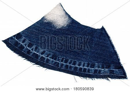 Piece of dark blue jeans fabric isolated on white background. Rough uneven edges.