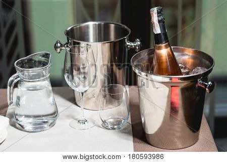 Bottle of champagne in bucket in a restaurant.