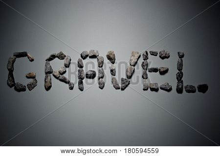 Letters From Gravel On Gray Background. Wrote Gravel.copy Space