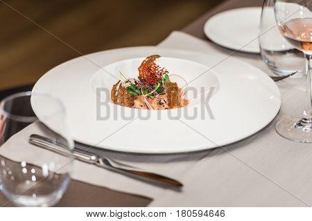delicious salmon in a restaurant. small portion.