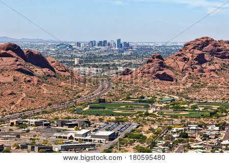 Downtown Phoenix Arizona aerial view from Scottsdale framed between the Papago Buttes