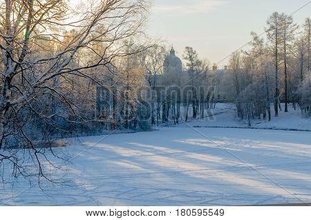 Winter landscape with frozen lake forest backdrop