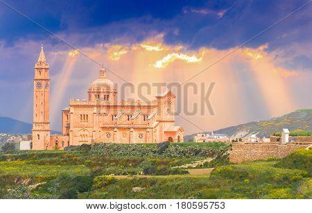 Ta Pinu church sanctuary on Gozo island illuminated by sunset light in Malta - Europe