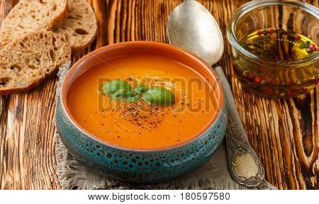 Delicious carrot soup with spices and Basil. Vegetarian diet food. Selective focus