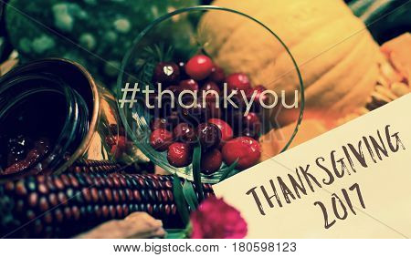 Thanksgiving Thank You Card in Autumn Harvest Gift Basket with written words Thank You In hashtag and Thanksgiving 2017