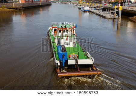 The river tugboat along the river Weser in the city of Bremen.