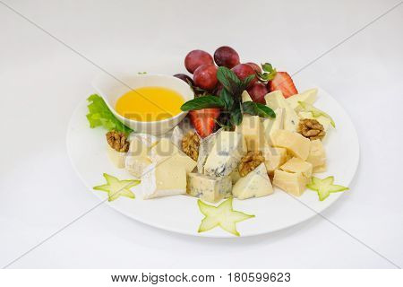 Assorted Cheeses On White Plate