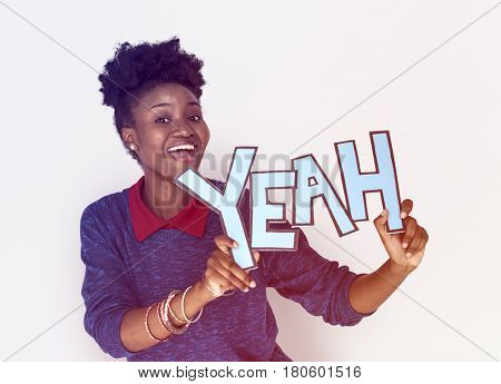 Smiling African Woman Holding Yeah Word