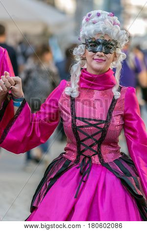 TIMISOARA ROMANIA - MARCH 31 2017: Woman on the street dressed in period costumes and present on the street inside the CheckART Carnival organized by the City Hall Timisoara.