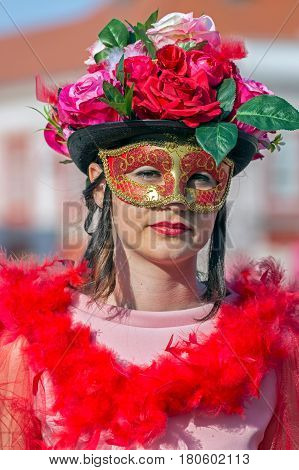 TIMISOARA ROMANIA - MARCH 31 2017: Woman dressed in period costumes and present on the street inside the CheckART Carnival organized by the City Hall Timisoara.