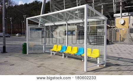 Gdynia, Poland - April 08, 2017: Bus stop in the shape of a football goal. Yellow blue chair.