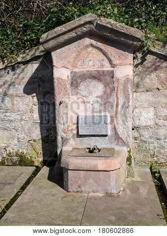The Conqueror's Well on the bank of the River Tweed.