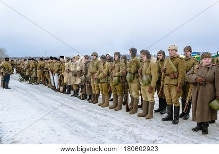 Leningrad region, Russia - 29 Jan 2017: people, dressed in the uniform of the red Army soldiers standing in battle formation on the reconstruction of military events