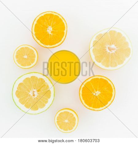 Citrus fruits and juice made of lemon, orange, sweetie isolated on white background. Flat lay, top view. Summer background