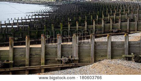 Compressed view of groynes on a beach at Eastbourne UK