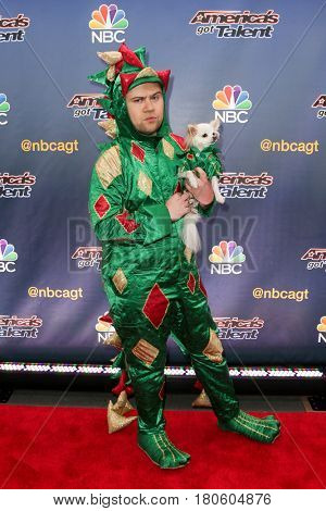 NEW YORK-AUG 11: Comedian Piff the Magic Dragon and Mr. Piffles, the Chihuahua attend the 'America's Got Talent' season 10 taping at Radio City Music Hall on August 11, 2015 in New York City.